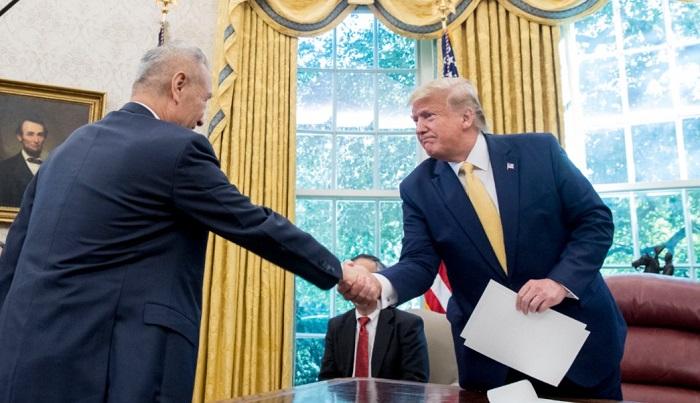 Alcanzan Estados Unidos y China acuerdo parcial para una tregua en su guerra comercial